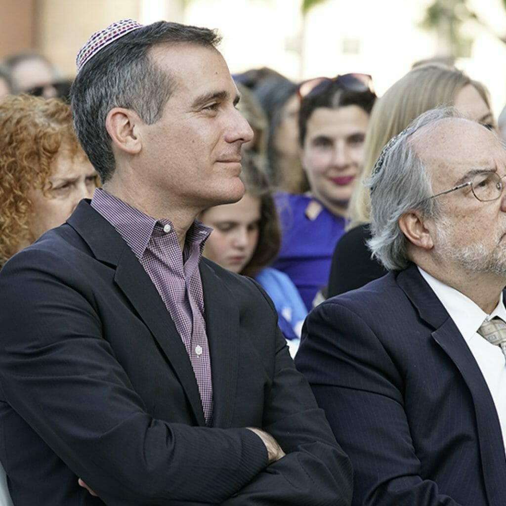 Mayor Eric Garcetti and Rabbi Eddie Feinstein listening attentively