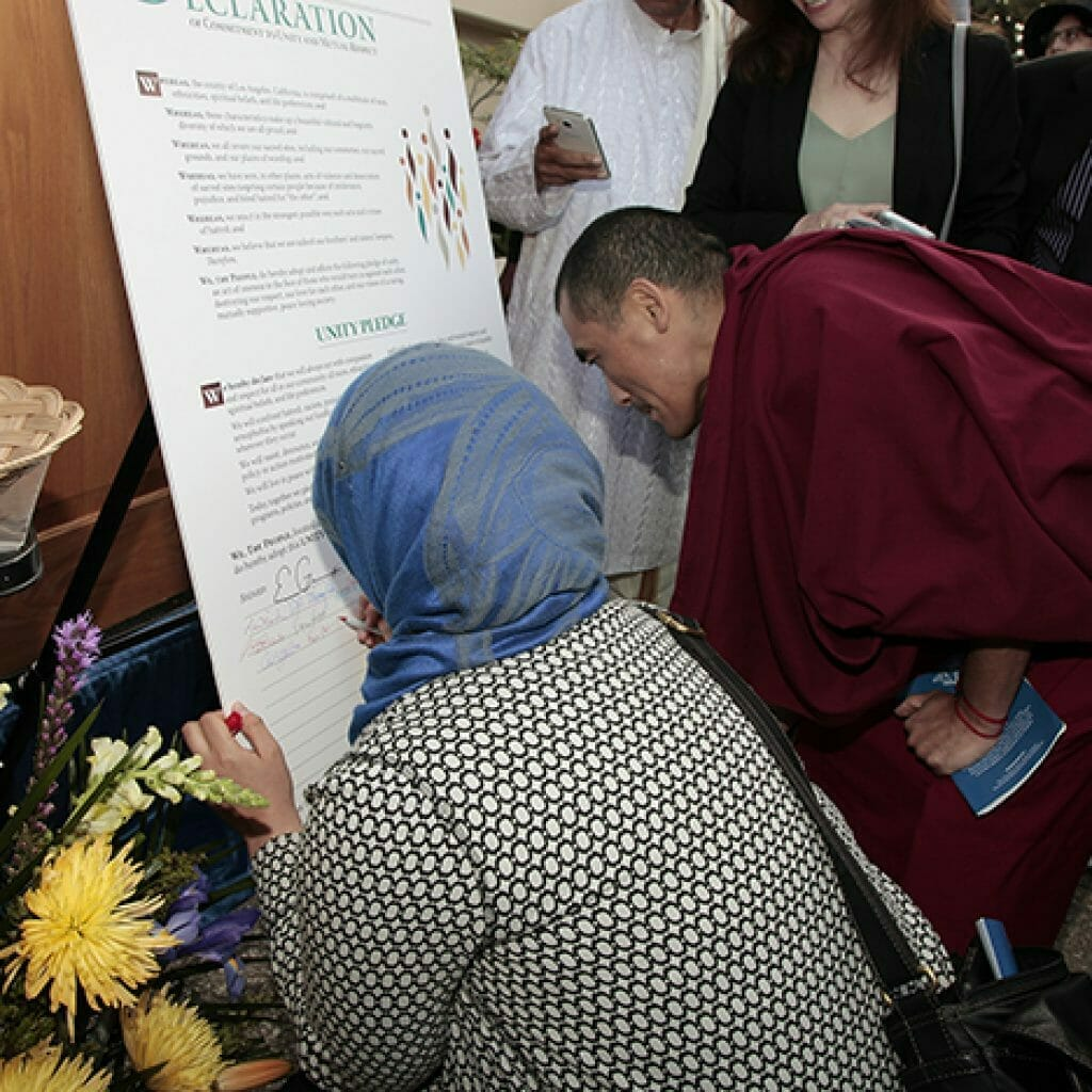 Dr. Rose Aslan from Islamic Center of the West Valley signs the Unity Pledge