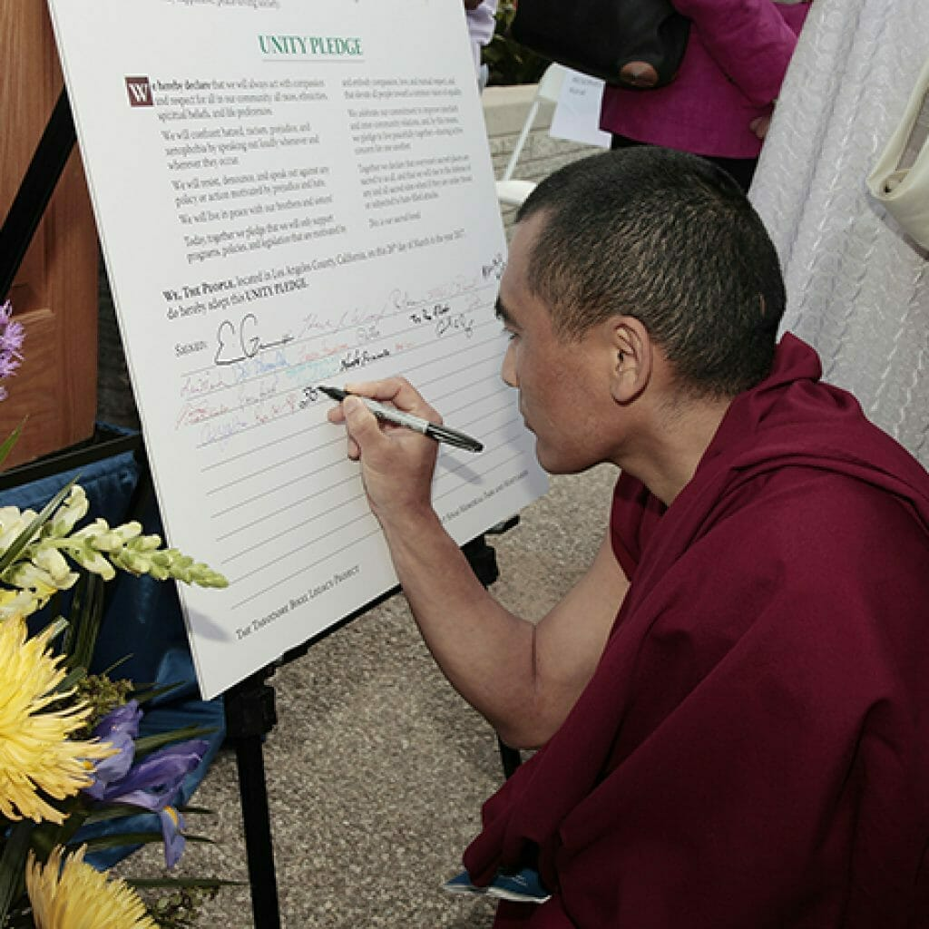 Signing the Unity Pledge