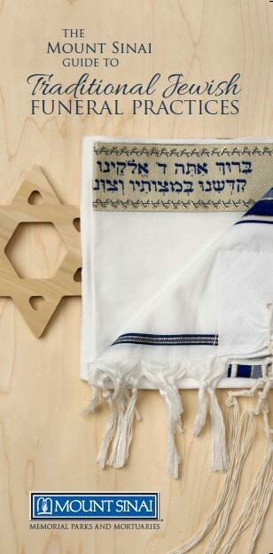 Cover of Funeral Guide. Shows close up of Tallit along with a wooden Star of David